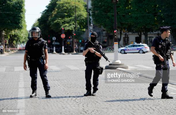 Graphic content / Antiriot police officers patrol the ChampsElysees avenue on June 19 2017 in Paris after a car crashed into a police van before...
