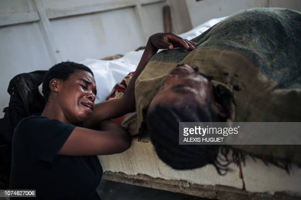 Graphic content / At the morgue of Beni hospital a woman mourns the death of her sister amongst the civilians killed in an attack in Masiani district...