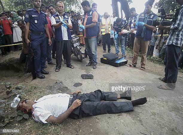 Graphic content / Bangladeshi investigators look over the body of 58yearold homeopathic doctor Sanaur Rahman after unknown assailants hacked him to...
