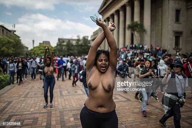 Graphic content / Bare chest students gesture at the University of Witwatersrand in Johannesburg on October 4 2016 in an act of defiance against...
