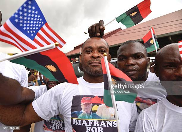 Graphic content / Biafrans wearing Tshirts with the image of the president elect wave the US flag and the former Republic of Biafra flag as they...