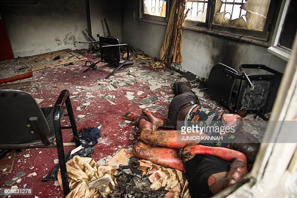 Graphic content / Bodies are pictured on September 20 2016 in the offices of the main opposition Union for Democracy and Social Progress party which...