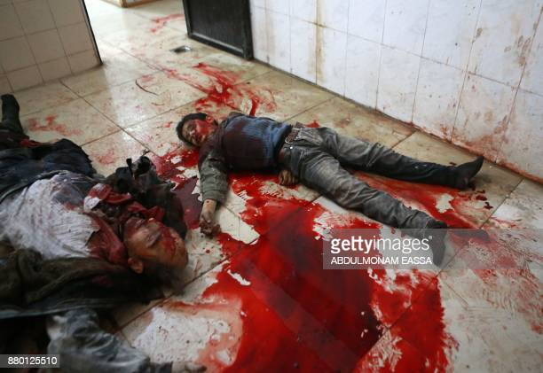 Graphic content / Bodies are seen at a makeshift morgue in the rebelcontrolled town of Hamouria in the eastern Ghouta region on the outskirts of the...