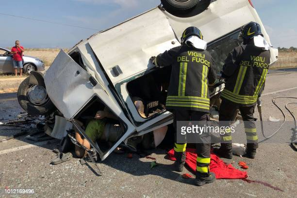 Graphic content / Bodies are seen in a vehicle as firefighters work at the site where a van smashed into a lorry killing 12 migrant agricultural...