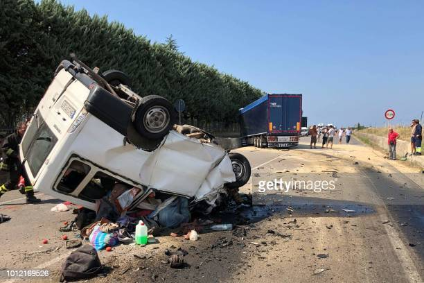 Graphic content / Bodies are seen in a vehicle as People stand at the site where a van smashed into a lorry killing 12 migrant agricultural workers...