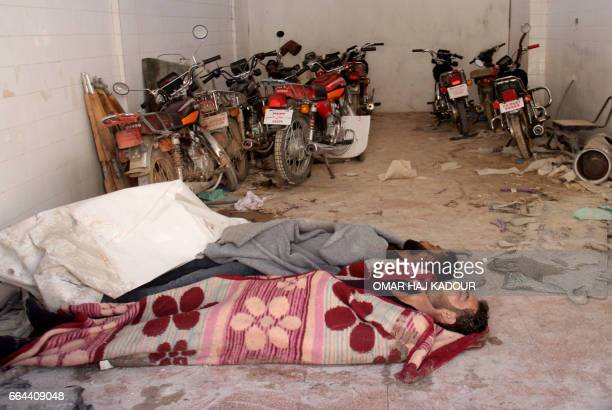 Graphic content / Bodies lie in the parking area of a hospital in Khan Sheikhun a rebelheld town in the northwestern Syrian Idlib province following...