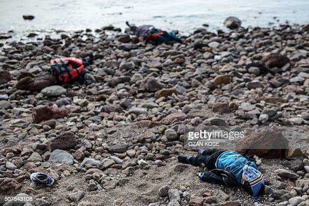 Graphic content / Bodies of migrant children and a woman are washed up on the beach in Canakkale's Bademli district on January 30 2016 after at least...