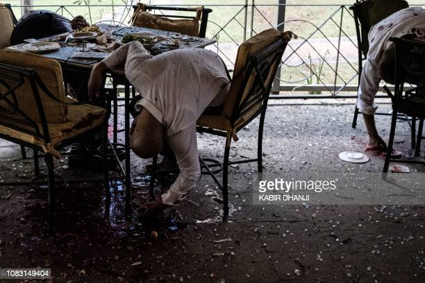 Graphic content / Bodies of victims are seen at the terrace of a restaurant after the bomb attack at a hotel complex in Nairobi's Westlands suburb on...