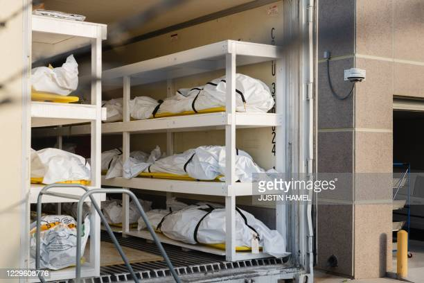 Graphic content / Bodies wrapped in plastic line the walls inside a refrigerated trailer used as a mobile morgue by the El Paso County Medical...
