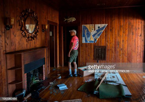 Graphic content / Bruce Christensen looks at an empty room after a storm surge sucked out most of their belongings in Port St Joe Florida on October...