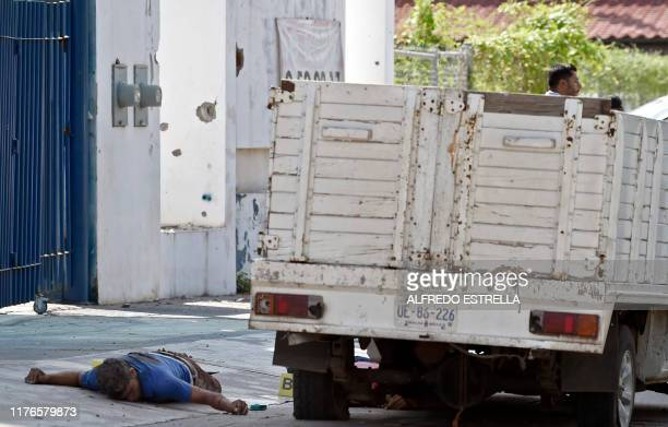 Graphic content / Corpses lie on the street after heavily armed gunmen waged an allout battle against Mexican security forces in Culiacan Sinaloa...