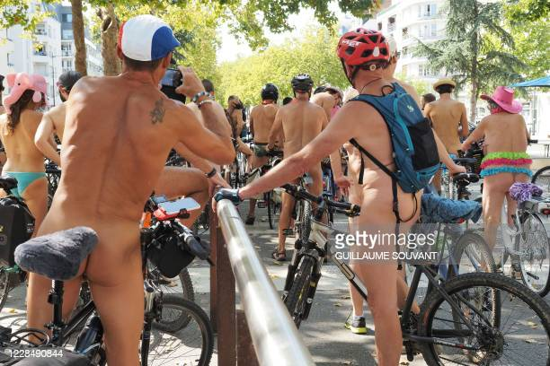 Graphic content / Cyclists take part in the 'Cyclonudista' naked bike ride around Rennes, western France, on September 13, 2020. - Naked cyclists...