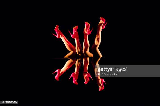 Graphic content / Dancers perform during the show Upside down on the stage of the Parisian cabaret Crazy Horse on September 14 2017 in Paris The...