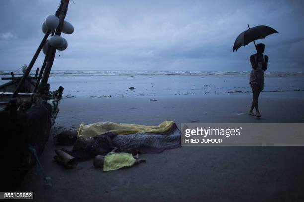 Graphic content / Dead bodies of Rohingya Muslim refugees lay on the shore of Inani beach near Cox's Bazar on September 28 2017 On September 28 at...