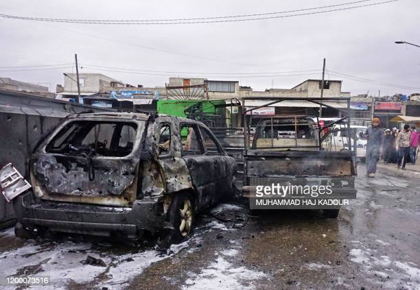 Graphic content / Destroyed cars are pictured at the site of a reported airstrike on the industrial area of Idlib in Northern Syria on February 11...