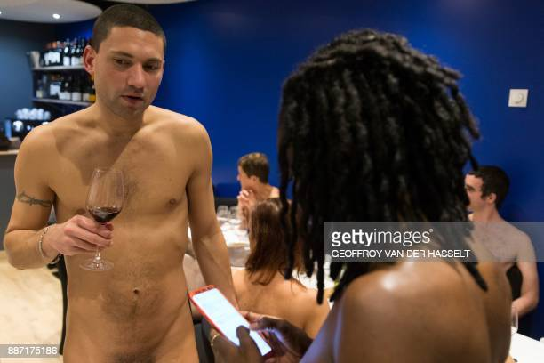 Graphic content / Diners chat in the nude at the newly opened nudist restaurant o'naturel in Paris on December 5 2017 Leave your coats your pants and...