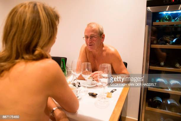 Graphic content / Diners eat in the nude at the newly opened nudist restaurant o'naturel in Paris on December 5 2017 Leave your coats your pants and...