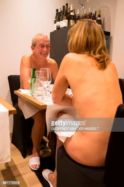 Graphic content / Diners eat in the nude at the newly opened nudist restaurant 'o'naturel' in Paris on December 5 2017 Leave your coats your pants...
