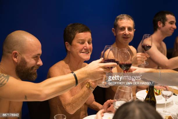 Graphic content / Diners toast in the nude at the newly opened nudist restaurant 'o'naturel' in Paris on December 5 2017 Leave your coats your pants...