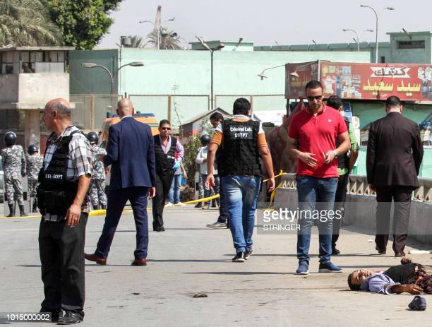 Graphic content / Egyptian investigators gather around the body of a suicide bomber whose explosives detonated before reaching the Coptic Orthodox...