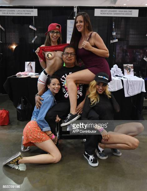 Graphic content / Fans pose for photos with performers during the annual 'AdultCon' Adult Entertainment Convention in Los Angeles California on...