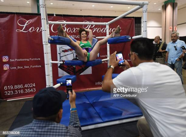Graphic content / Fans take photos of a performer during the annual 'AdultCon' Adult Entertainment Convention in Los Angeles California on September...