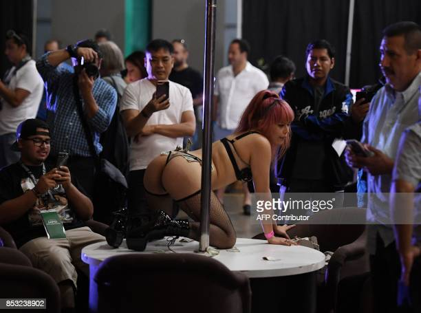 Graphic content / Fans take photos of performers during the annual 'AdultCon' Adult Entertainment Convention in Los Angeles California on September...