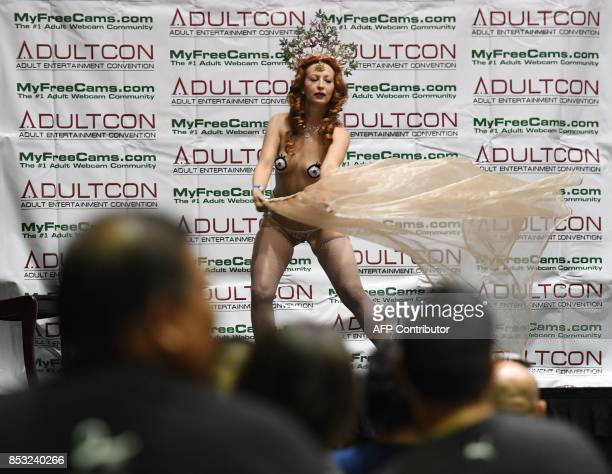 Graphic content / Fans watch a performer on stage during the annual 'AdultCon' Adult Entertainment Convention in Los Angeles California on September...