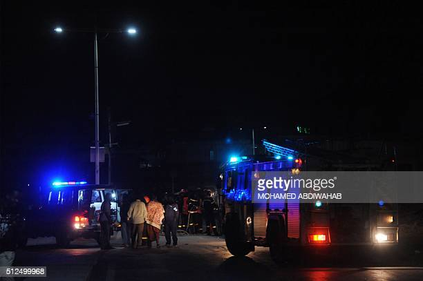 Graphic content / Firefighters and police officers work near the SYL hotel after an attack in the center of Mogadishu on February 26 2016 At least 12...