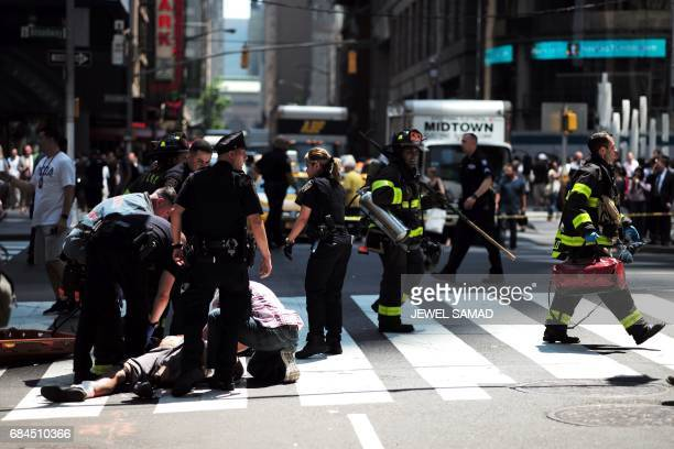 Graphic content / First responders arrive at the scene after a car plunged into pedestrians in Times Square in New York on May 18 2017 A car plowed...