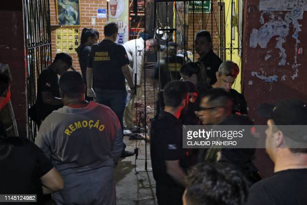 Graphic content / Forensic personnel and criminal police remove corpses from a bar in Belem Para state Brazil on May 19 2019 At least 11 people were...