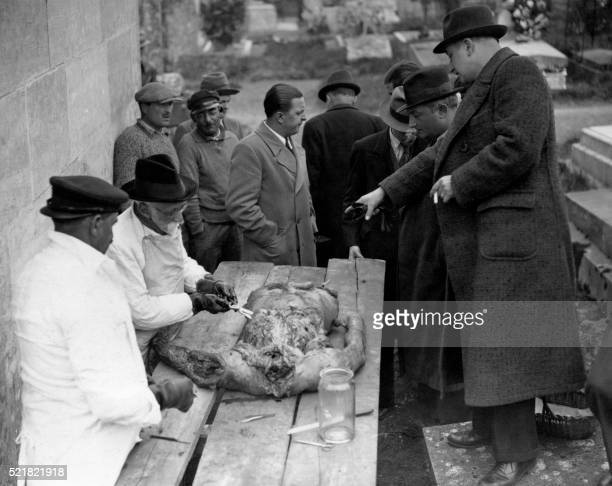 Graphic content / Forensic physicians proceed in an autopsy on a corpse on April 16 1938 at a morgue of Paris