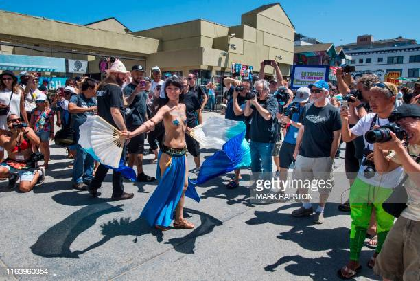 Graphic content / GoTopless Day demonstrators march during their annual protest for women's rights in Venice Beach California on August 25 2019 The...