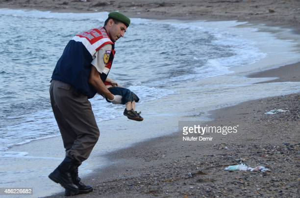 Graphic content / GRAPHIC CONTENT A Turkish police officer carries a migrant child's dead body off the shores in Bodrum, southern Turkey, on...