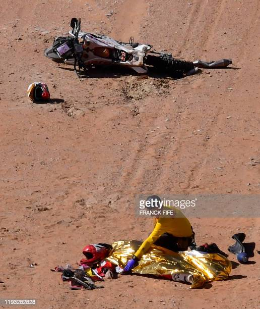 Graphic content / Hero's Portuguese motorbike rider Paulo Goncalves is attended by medical staff after a crash during the Stage 7 of the Dakar 2020...