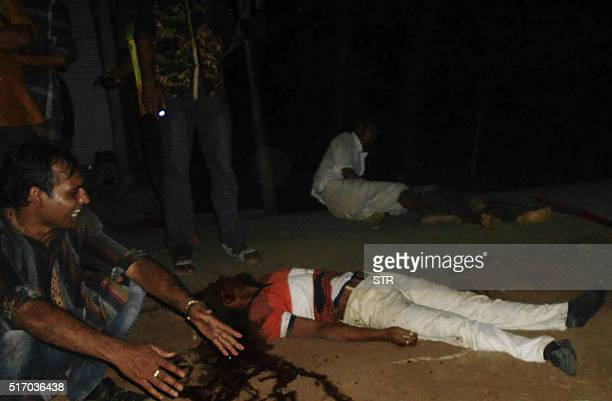 Graphic content / In this photograph taken on March 22 the body of a Bangladeshi man killed during postelection violence lies in a street in Pirojpur...