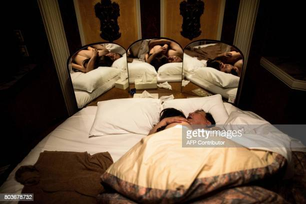 Graphic content / In this picture taken early on June 14 62yearold Senji Nakajima hugs his silicone sex doll Saori while sleeping at a love hotel in...