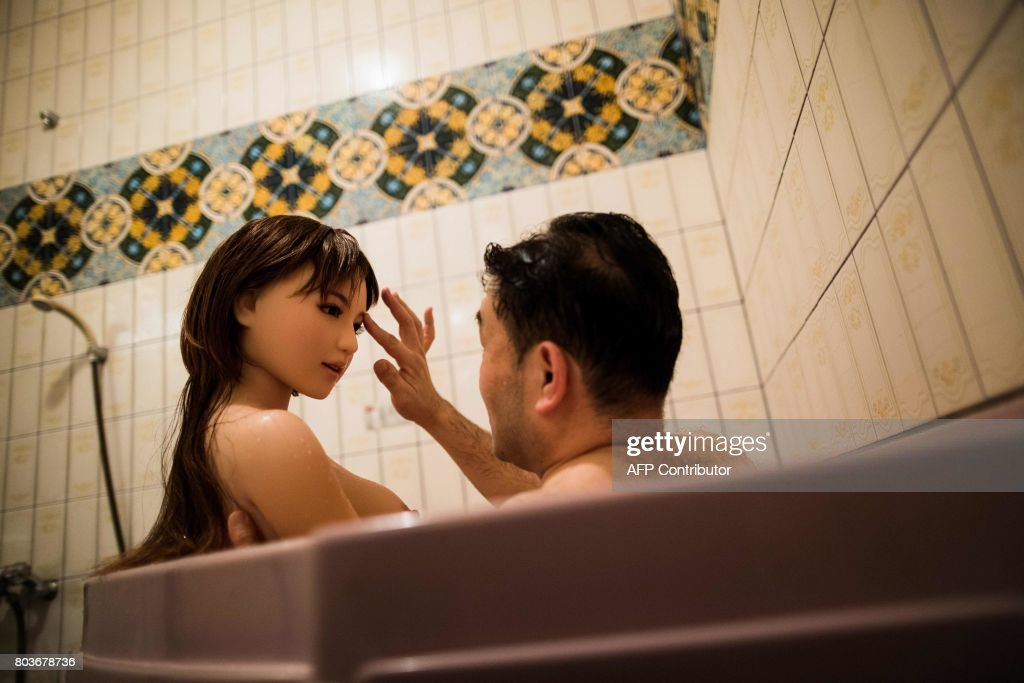 Graphic content / In this picture taken late on June 13, 2017, physiotherapist Masayuki Ozaki takes a bath with his silicone sex doll Mayu at a love hotel in Yachimata, Chiba prefecture. Around 2,000 of the life-like dolls -- which cost around 6,000 USD and come with adjustable fingers, removable head and life-like genitals -- are sold each year in Japan, according to industry insiders. / AFP PHOTO / Behrouz MEHRI / TO GO WITH Japan-social-lifestyle,FEATURE by Alastair HIMMER