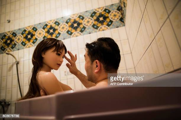 Graphic content / In this picture taken late on June 13 physiotherapist Masayuki Ozaki takes a bath with his silicone sex doll Mayu at a love hotel...