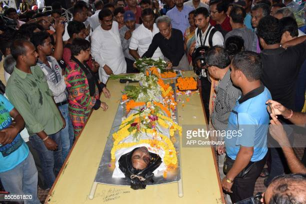 Graphic content / Indian journalists pay their respects to their slain colleague Shantanu Bhowmick who was beaten to death during violent clashes in...
