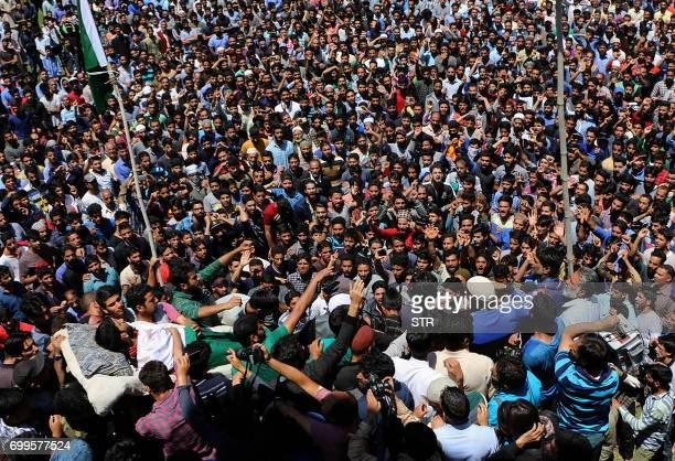 Graphic content / Indian Kashmiri villagers carry the body of Kashmiri protester Tawseef Ahmed during his funeral procession at Pulwama south of...