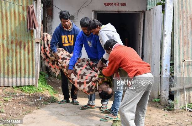 Graphic content / Indian villagers carry a dead body of a victim killed by drinking toxic bootleg liquor at Kushal Konwar Civil Hospital in Golaghat...