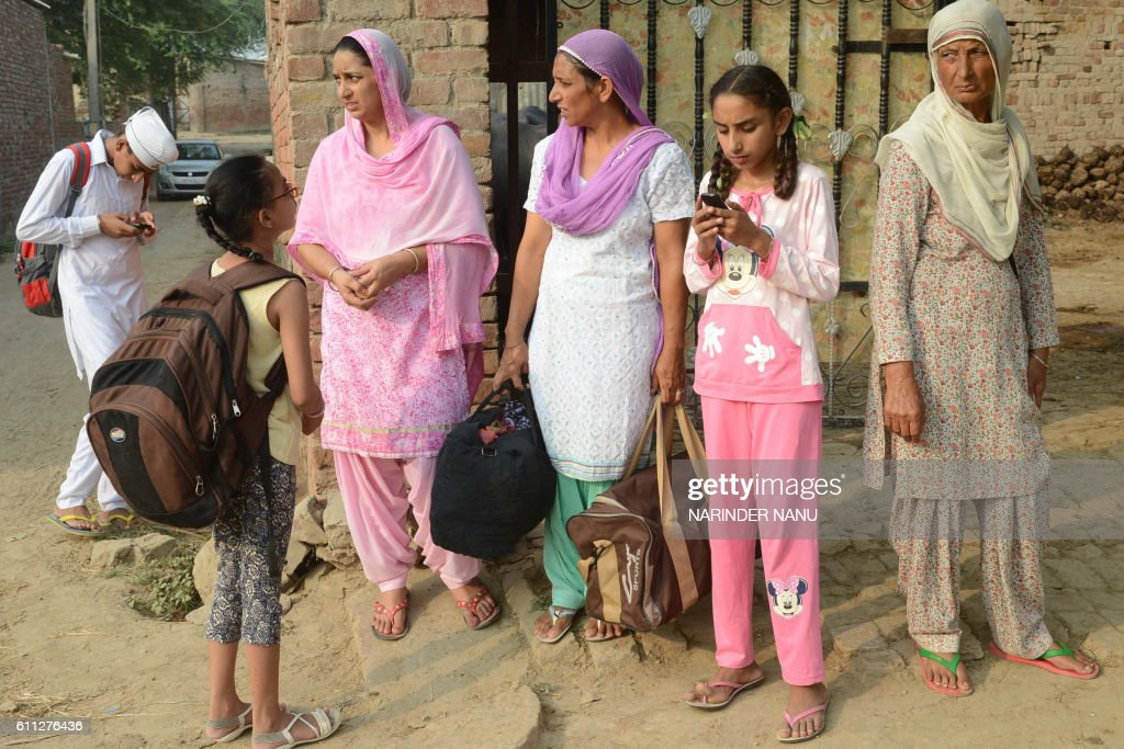 Graphic content / Indian villagers from the IndiaPakistan border area wait for the bus as they evacuate from the border village of Neshta about 35...