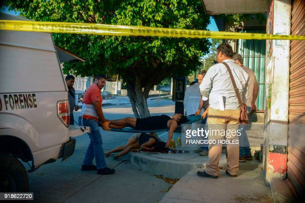 Graphic content / Investigators lift the corpses of two women killed on Rufo Figueroa neighborhood of Acapulco city port Guerrero state Mexico on...