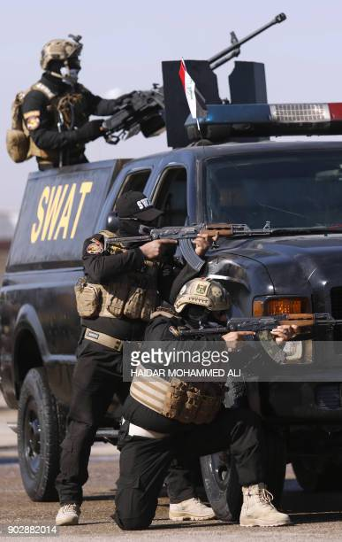 Graphic content / Iraqi police special forces take part in a parade to mark the national police day on January 9 2018 in the southern city of Basra /...
