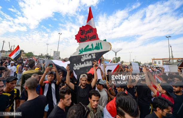Graphic content / Iraqi protesters take to the streets to mark the first anniversary of a massive anti-government movement demanding the ouster of...