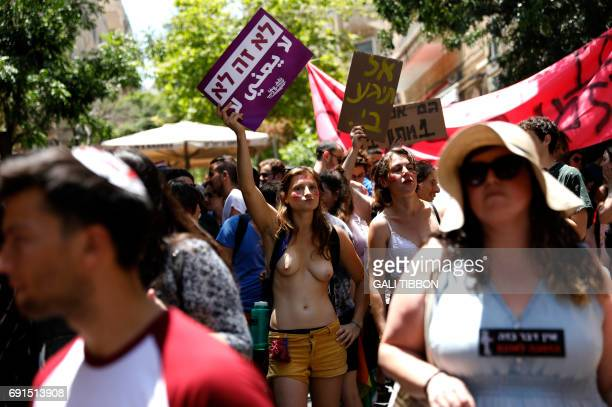Graphic content / Israeli activists chant slogans as they carry placards during the 6th annual SlutWalk march through central Jerusalem on June 2 to...