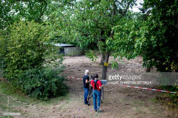 Graphic content / Journalists film in front of a police cordon at the site after the police finished a two-day search in a garden allotment in the...