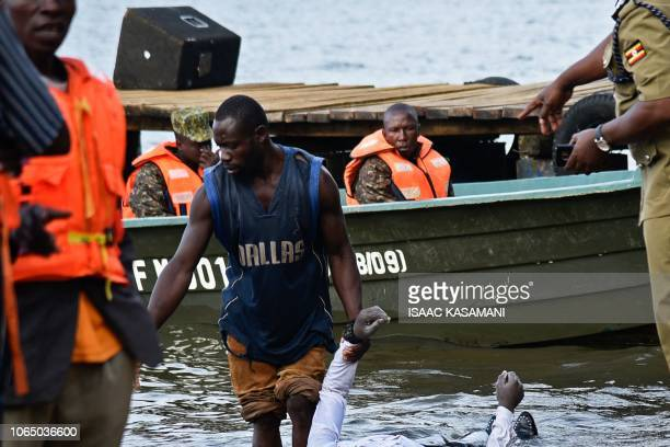 Graphic content / Local fishermen and Ugandan Navy personnel collect bodies of victims by capsized cruise boat on lake Victoria at Mutima village...