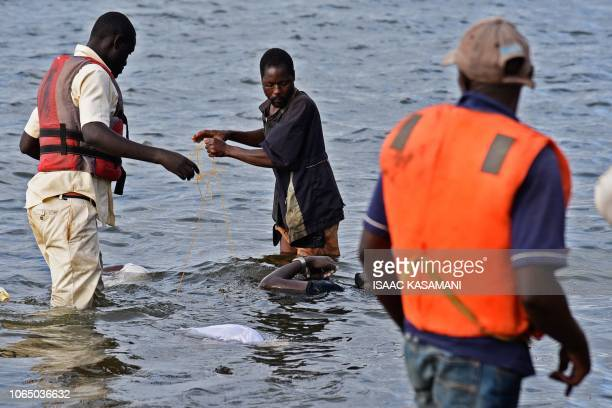 Graphic content / Local fishermen collect bodies of victims by capsized cruise boat on lake Victoria at Mutima village about 50km south of capital...